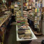 libreria acqua alta - venice book store with gondolala