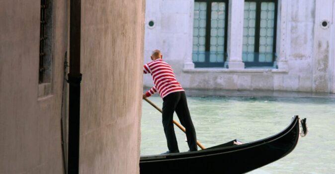 gondola by rialto in a canal